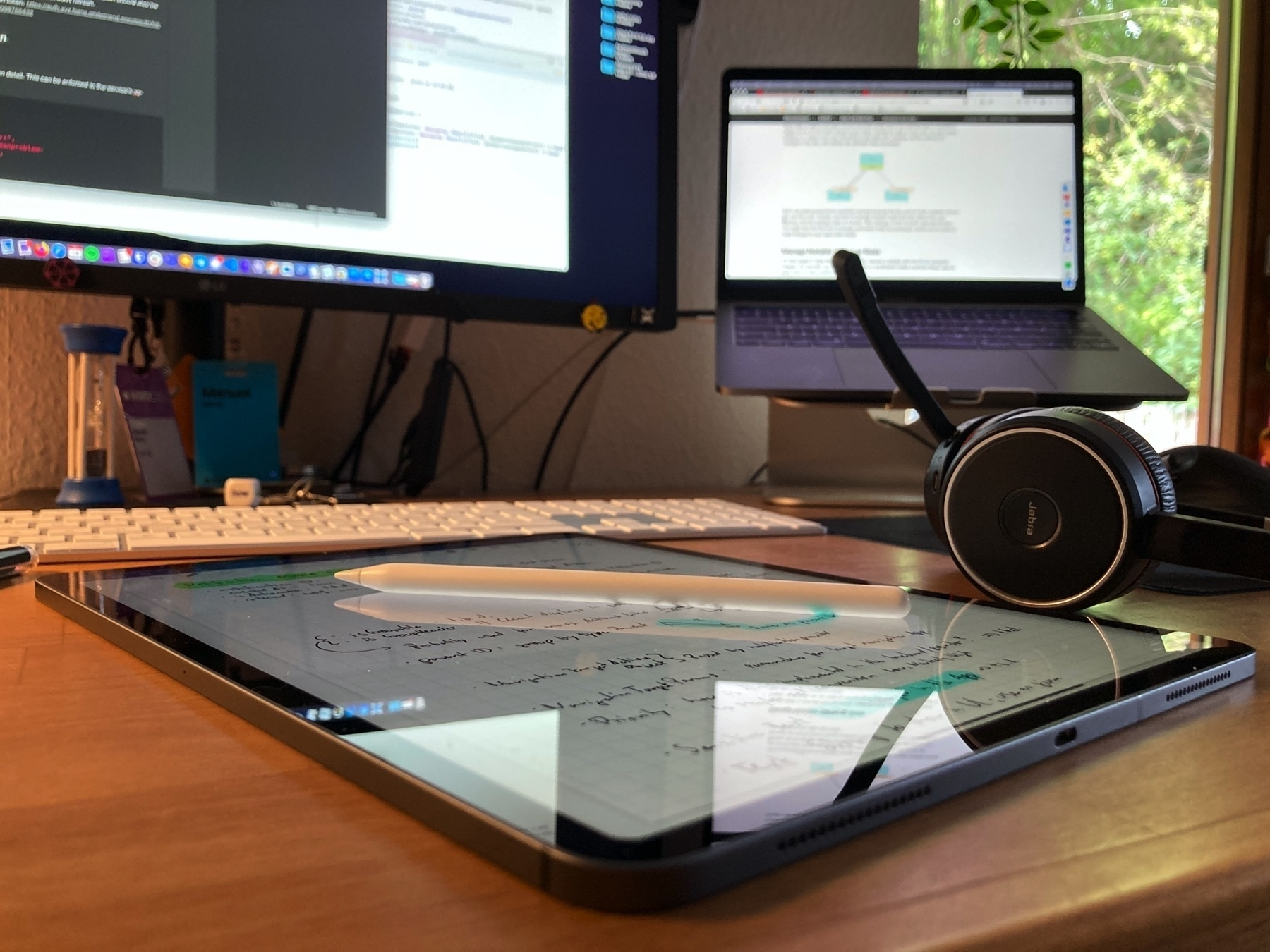 Desk with monitor, iPad and headset.
